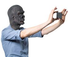Man In Gorilla Mask Taking Sel...