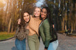 canvas print picture - Trio of pretty teen girls posing in public park