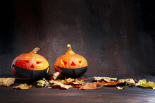 Halloween. Image Featuring Two Pumpkins With Burning Candles And Lightning