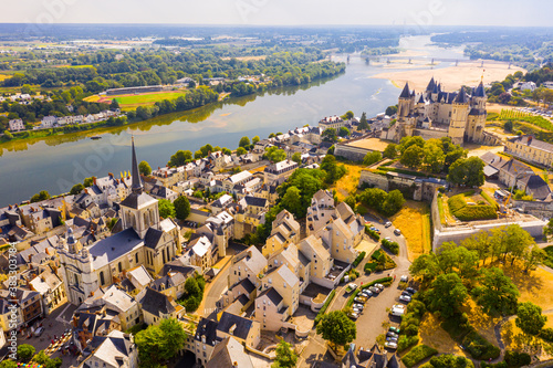 Scenic aerial view of Saumur town on banks of Loire in western France overlooking ancient castle and parish church in summer Canvas Print