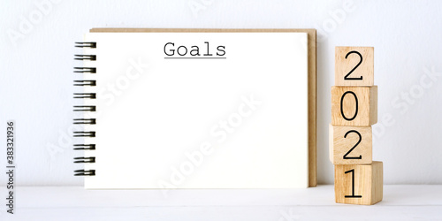 Fototapeta 2021 goals and blank notebook paper on white marble background, 2021 business new year aim to success obraz