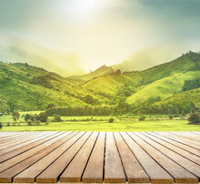 Wooden Table Top With The Mountain Landscape Background