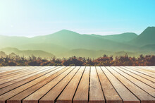 Empty Wooden Table Top With The Mountain Landscape Against Sunset Sky
