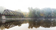 Moody Abandoned Train Bridge Over The Pemi River In New Hampshire. Fall Foliage Leaves Changing, Misty River In The Morning Bg