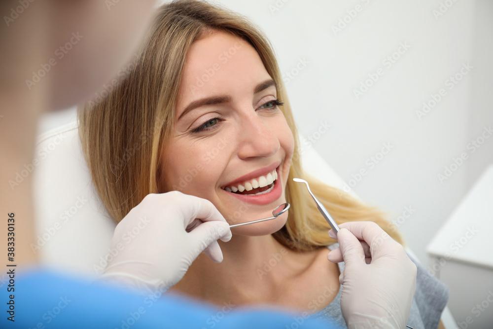 Fototapeta Doctor examining patient's teeth in clinic, closeup. Cosmetic dentistry