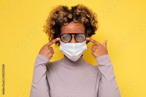Valokuvatapetti African american woman with foggy glasses caused by wearing a COVID protective m