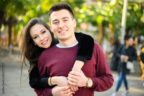 Fototapeta Young couple hugging outdoor with love obraz