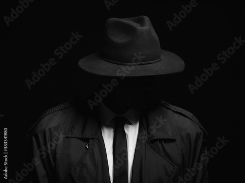 Fototapety, obrazy: Old fashioned detective in hat on dark background