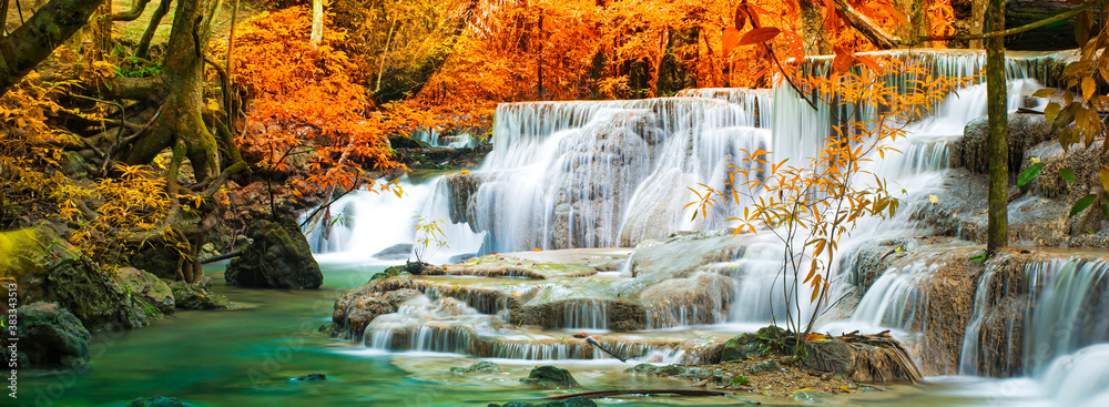 Fototapeta Amazing in nature, beautiful waterfall at colorful autumn forest in fall season
