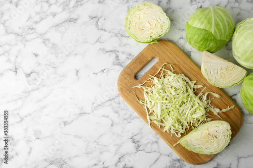Chopped ripe cabbage on white marble table, flat lay Canvas Print
