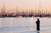 Surf Fishing In Front A Marina, Santa Barbara, California