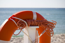 Lifebuoy And Orange Rope Hangi...