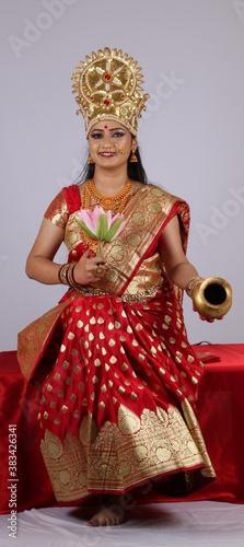 Valokuva Indian Godess of prosperity / Lakshmi isolated on white.