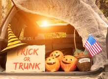 Trick Or Trunk. Concept Celebrating Halloween In Trunk Of Car. New Trend Celebrating Traditional October Holiday Outdoor. Social Distance And Safe Alternative Celebration During Coronavirus Covid-19
