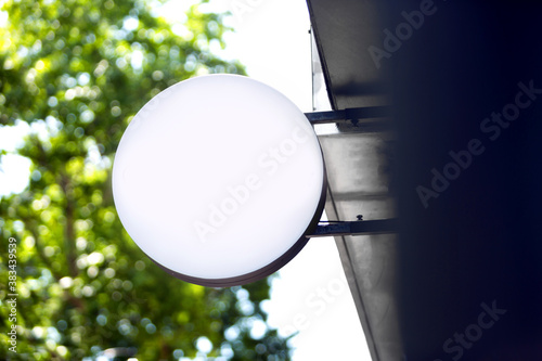 Blank sign board on a shop wall