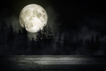 Wooden Table Top With Forest In The Dark Night And Fog Or Mist With Full Moon In Background. (Elements Of This Image Furnished By NASA.)