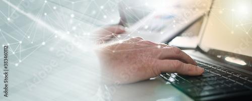 Fototapeta Businessman typing on a laptop; panoramic banner obraz na płótnie