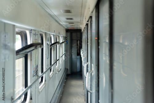 Fototapeta Empty corridor in the sleeping car of train. Rail travel.