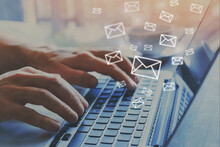 Email Marketing Concept, E-mail Icons, Hands Typing On Keyboard As Background