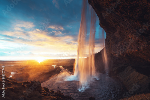 Fotografie, Obraz Seljalandsfoss waterfall at sunset, Iceland