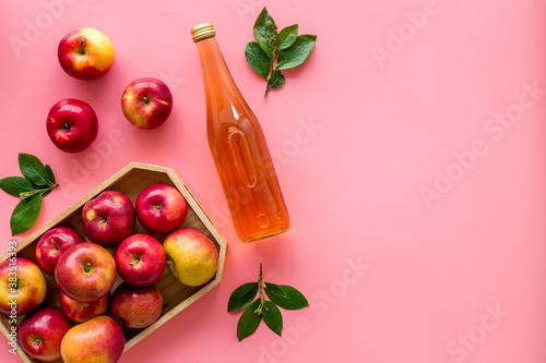 Fotografiet Apple cider vinegar in bottle with fruits top view