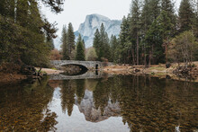 Scenic View Of Merced River And Pohono Bridge Against Half Dome