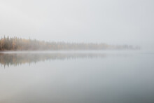 Thick Morning Fog On Lake
