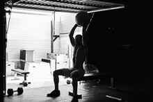 Fit Young Man Working Out With...