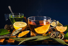 Tea Served With Lemon, Spices And Eucalyptus Leaves On Table