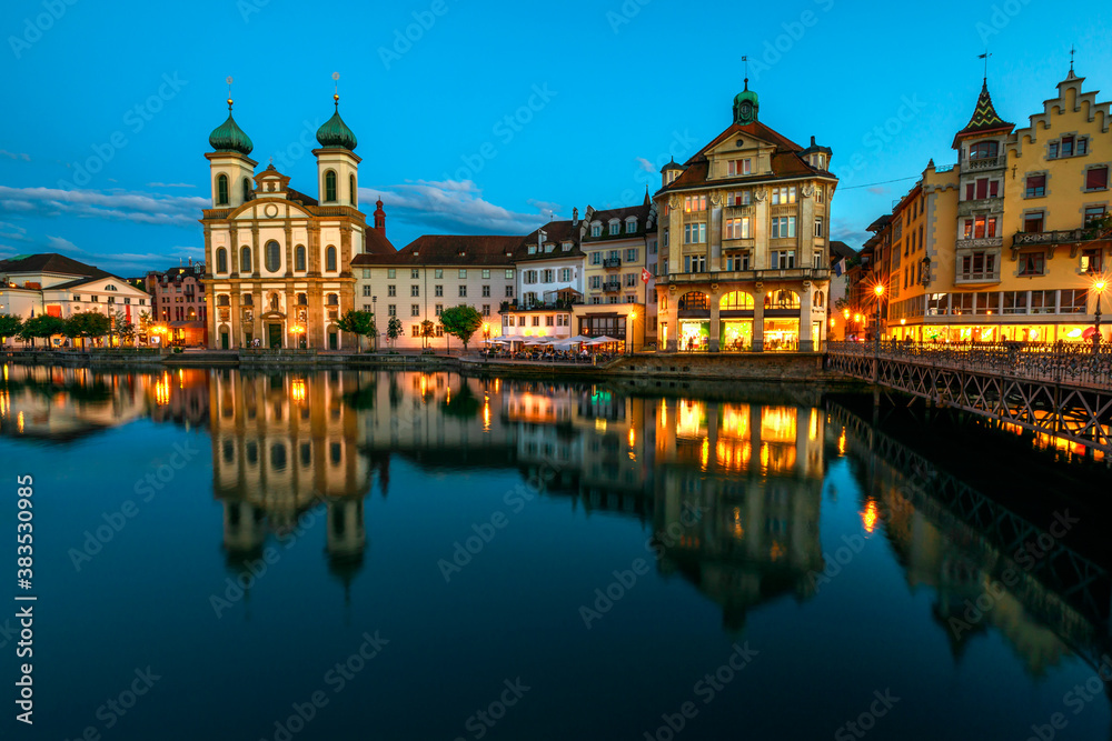 Fototapeta Lucerne cityscape by twilight and Lake Lucerne, Vierwaldstatersee, Canton of Lucerne in Central Switzerland. Jesuitenkirche or Jesuit Church reflects on Reuss river. Famous landmark of historical city