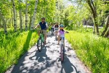 A Family Enjoys A Bike Ride On A Bike Path In South Lake Tahoe, CA