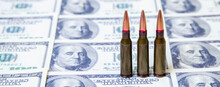 The Bloody Business Of War. Bullets On US Dollar Bills