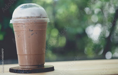 Fototapeta Iced coffee or mocha in take away cup