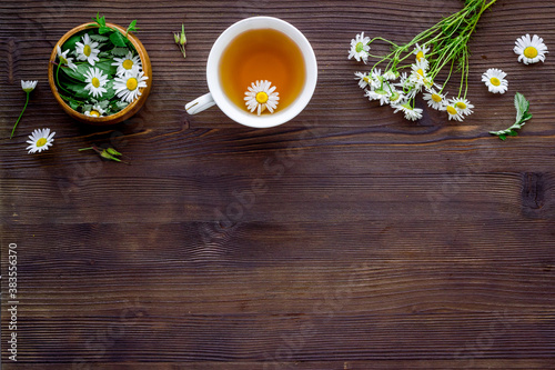 Herbal tea - green herbs and wild flowers, top view