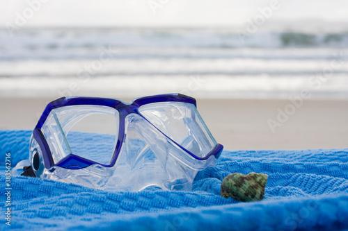 Diving mask on blue towel