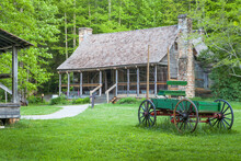 Old Fashioned Mountain Logger Cabin And Horse Drawn Wagon.