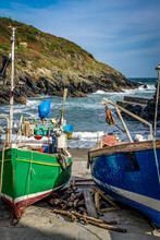Beached Fishing Boats In Small Village Harbour