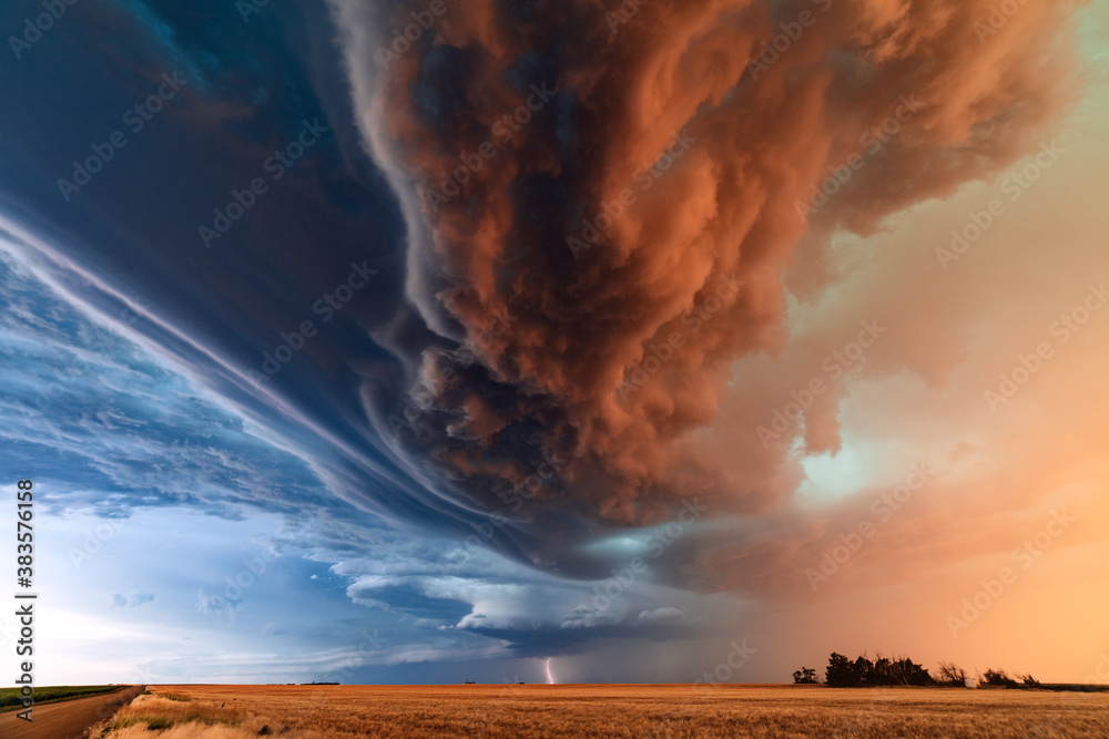 Fototapeta Supercell thunderstorm with dramatic storm clouds and lightning