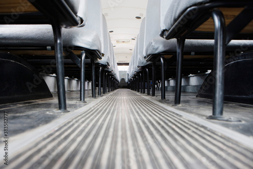 Aisle between seats in empty school bus
