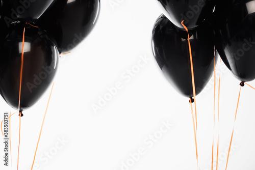 Fototapeta Black festive balloons with strings isolated on white obraz