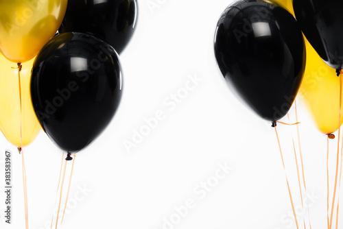 Fototapeta Black and yellow festive balloons isolated on white obraz