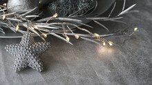 Closeup Of Elegant Silver Grey Christmas Decoration With Light Chain And  Star