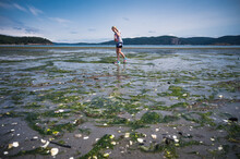 Young Girl Walking On Beach At Low Tide On Lopez Island