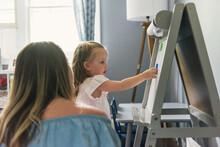 Daughter Placing Letter On Alp...