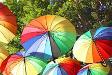 Rainbow Umbrellas Hanging From...