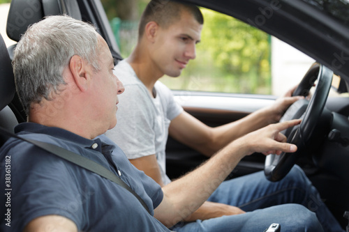young man having a accompanied driving lesson