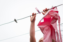 Little Girl Hanging Clothes On...