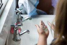 Child Washing Hands At Old-fas...