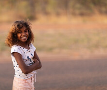 Smiling Young Girl Standing Ou...