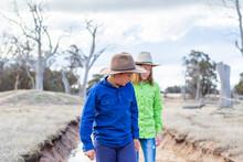 Two Country Kids Walking Along...